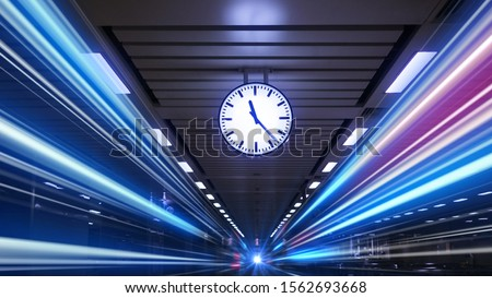 Photo of  Rush hour Fast moving  evening ,Fast moving traffic drives   time lapse clock moving fast light each subway lane effect line light cg