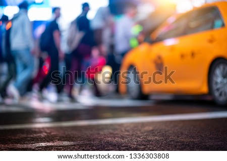 Rush hour in New York City. A defocused colorful abstract background with typical yellow cab and pedestrians crossing the street. stock photo