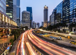 Rush hour traffic in Jakarta business district along the city main avenue, Jalan Sudirman, at night in Indonesia capital city