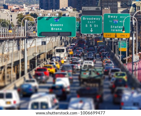 Rush hour traffic jam on the Williamsburg Bridge in Brooklyn, New York City blurred background