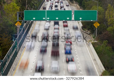 Rush hour traffic on Interstate Highway 110 Pasadena Freeway, into downtown Los Angeles California stock photo
