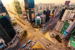 Rush hour traffic zips through an intersection in the Gangnam district of Seoul, South Korea.