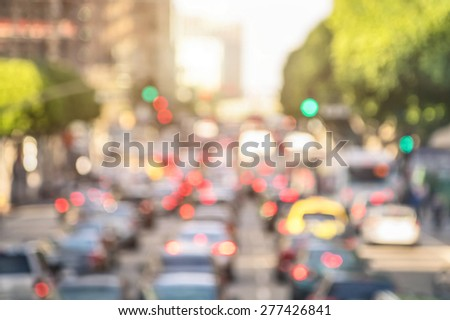 Rush hour with defocused cars and generic vehicles - Traffic jam in Los Angeles downtown - Blurred bokeh postcard of american iconic city with bright daylight colors - Real life transportation concept #277426841