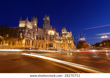rush of night time traffic at plaza de cibeles, madrid, spain