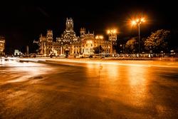 Rush of night time traffic at plaza de cibeles, madrid, spain ( HDR image )