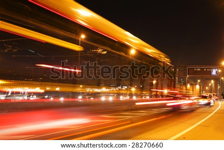 rush of night time traffic on road in  barcelona, spain