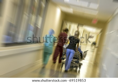 Rushing a patient to the emergency room for surgery with motion