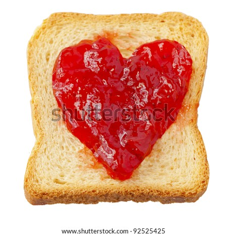 Rusk with strawberry jam in shape of heart