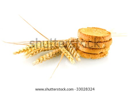 Rusk with wheat ear on white background