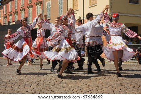 RUSSI - AUGUST 2: ensemble Tanok from Udmurt Republic of Russia - dancers in traditional dress performs folk dance during the International folklore festival on August 2, 2009 in Russi, RA, Italy  - stock photo