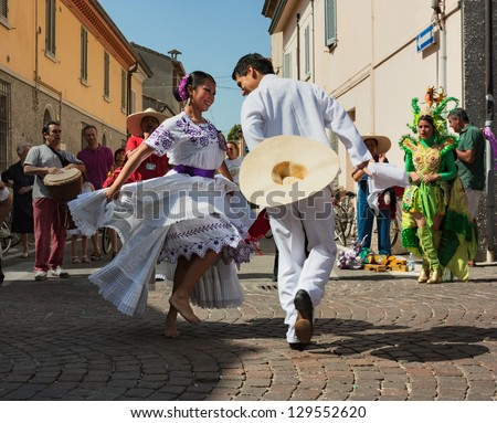 """RUSSI, ITALY - AUGUST 5: ensemble Imagenes de Peru' - couple of peruvian dancers performs traditional courting dance """"la marinera"""" at International folk festival on August 5, 2012 in Russi, RA, Italy"""
