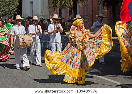 RUSSI, ITALY - AUGUST 5: street parade of ensemble Jocaycu from Colombia - colombian dancers in traditional dress performs folk dance at the International folk festival on August 5, 2012 in Russi RA, Italy
