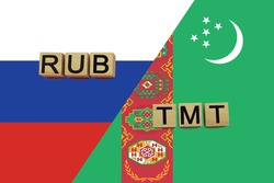 Russia and Turkmenistan currencies codes on national flags background. International money transfer concept