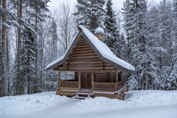Russia. Arkhangelsk region, January 2015. Museum of wooden architecture in the open. Wooden chapel in the forest.