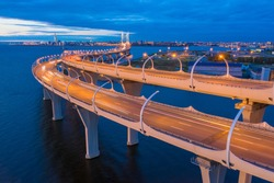 Russia. Bridges Of Saint Petersburg. The road through the Gulf of Finland. The River Neva. Modern highway. Road bridge at dawn. Industrial district of Petersburg. Panorama of the city from a height