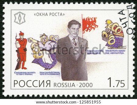 RUSSIA - CIRCA 2000: A stamp printed in Russia shows Vladimir V. Mayakovsky (1893-1930), poet, and propaganda posters, series National Cultural Milestones in the 20th Century, circa 2000