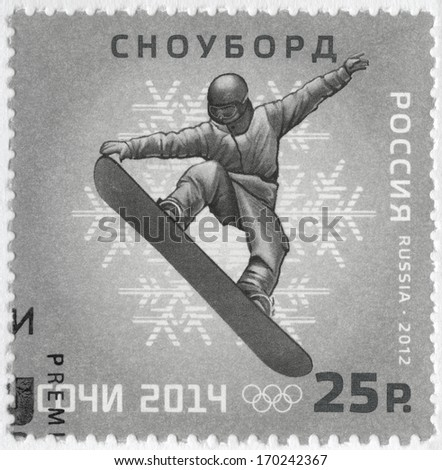 RUSSIA CIRCA 2012 A stamp printed in Russia shows XXII Olympic Winter Games in Sochi 2014 Olympic winter Sports snowboarding circa 2012