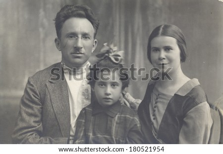 RUSSIA - CIRCA 1926s: Antique photo shows studio portrait of Family,  circa 1926s - stock photo