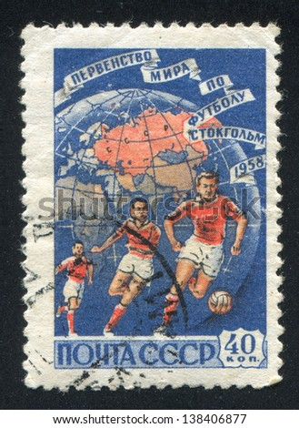 RUSSIA - CIRCA 1958: stamp printed by Russia, shows Soccer Players and Globe, circa 1958