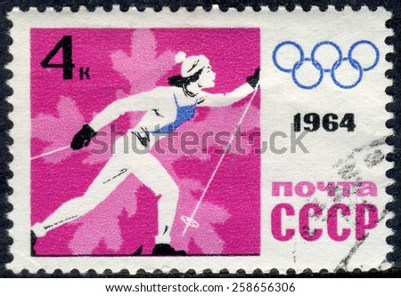 RUSSIA - CIRCA 1964: stamp printed by Russia, shows sport, skier, skiing, snowflake, winter circa 1964