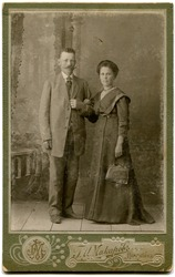 RUSSIA - CIRCA  the end of 19 - early 20 century: An antique photo shows couple, Namangan, the Russian Empire, now Uzbekistan Russian text: Makarov (photographer0, Namangan