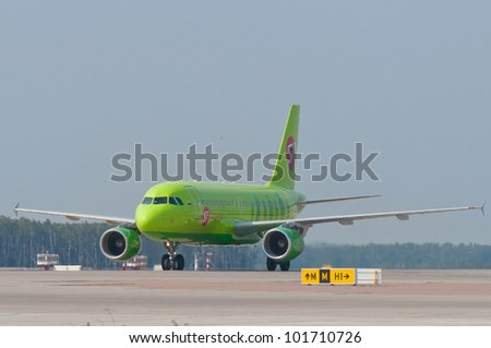 RUSSIA, DOMODEDOVO - 01 SEPTEMBER 2011: Airbus A320 jet aircraft operated by S7 is taxiing for arrival Moscow airport Domodedovo on September 01, 2011. S7 Airlines - Russia's third largest airline.