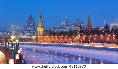 Russia. Ensemble of Moscow Kremlin and Moskva-City business center view across Moskva river at a winter night.
