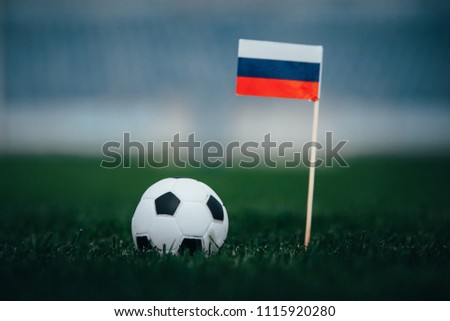 Russia Flag and Football ball on green grass - Original photo for world cup in Russia 2018 #1115920280