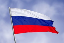 Russia flag isolated on sky background. close up waving flag of Russia. flag symbols of Russia.