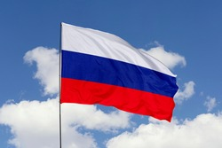 Russia flag isolated on the blue sky with clipping path. close up waving flag of Russia. flag symbols of Russia.