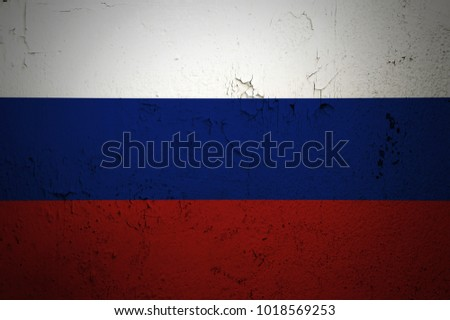 Russia flag on old grunge wall background retro effect image