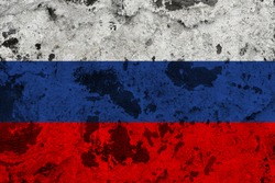 Russia flag on old wall. Patriotic grunge background. National flag of Russia