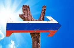 Russia Flag wooden sign with sky background