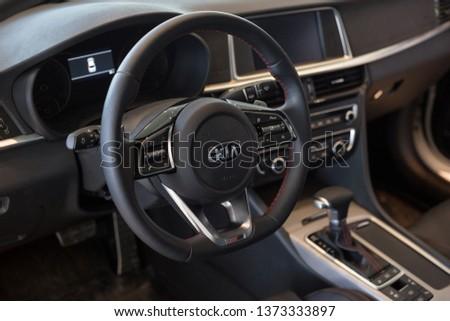Russia, Izhevsk - April 4, 2019: Showroom KIA. Interior of new Optima with automatic transmission. #1373333897