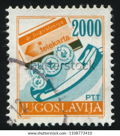 RUSSIA KALININGRAD, 12 NOVEMBER 2016: stamp printed by Yugoslavia, shows telephone receiver and telephone card, circa 1988
