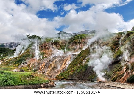 Photo of  Russia. Kamchatka. The mountains and fumaroles of the Valley of Geysers.