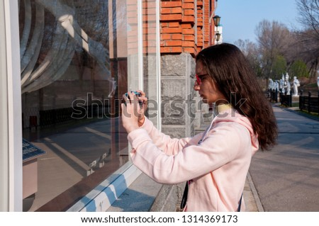 Russia, Khabarovsk, May 1, 2018: a girl takes pictures of the whale skeleton of the Khabarovsk Regional Museum. N.I. Grodekova
