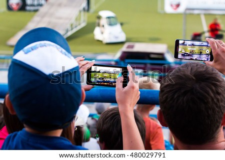 Russia, Kirov - August, 09, 2016: Spectators are taking pictures of extreme auto show in Kirov city in 2016 #480029791