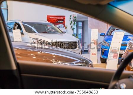 Russia, Kirov - October 18, 2017: Showroom and car of dealership Kia in Kirov city in 2016 #755048653