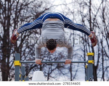 RUSSIA, MOSCOW - APRIL 18: Unidentified man on Street workout place on event of 80th anniversary of Spartak team in Luzhniki, Moscow, Russia, 2015
