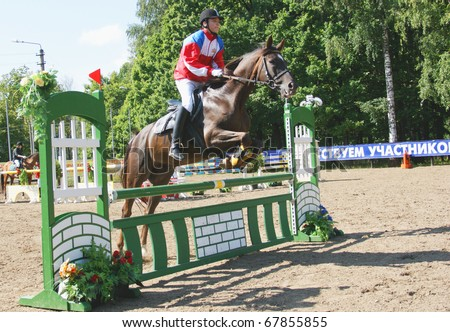 RUSSIA, MOSCOW - AUG 8: Sportsmen compete in equestrian sport \