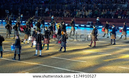 """RUSSIA, MOSCOW - AUGUST 30, 2018: A festival of military orchestras """"Spasskaya Tower"""" at Red Square. Presentation of the consolidated orchestra Celtic bagpipes  #1174910527"""