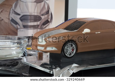 RUSSIA, MOSCOW -?? 4 DEC, 2014: A miniature model of the car and her sketch at the press event for Ford in SREDA loft.