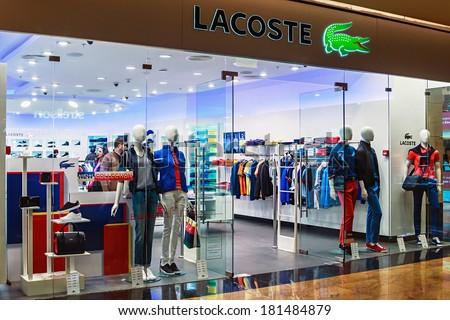 RUSSIA, MOSCOW - MARCH 10, 2014: Lacoste shop windows in a shopping center, Moscow. Is a French clothing company founded in 1933 that sells high-end clothing and most famously polo shirts.