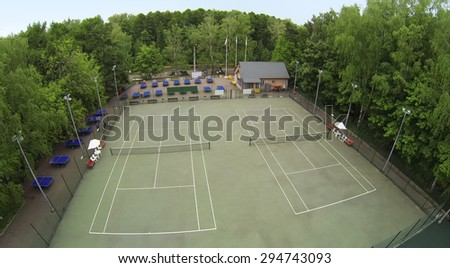 RUSSIA, MOSCOW - MAY 17, 2014: Two men play table tennis near courts in park Sokolniki at spring day. Aerial view