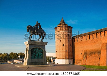 Photo of  Russia, Moscow region, Kolomna - monument to Dmitry Donskoy at the walls of the Kolomna Kremlin at sunset. Sight. Business card of the city of Kolomna.