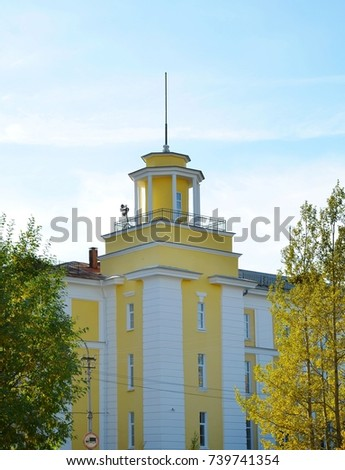 Russia, Murmansk region. Fragment of Monchegorsk Polytechnic College building - one of first buildings built in town. Tower with a spire. Leningrad style of architecture. Object of cultural heritage #739741354
