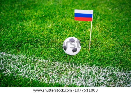 Russia national Flag and football ball on green grass. Fans, support photo, edit space.  #1077511883
