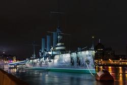 Russia, Neva embankment. Aurora, museum-ship in St. Petersburg. Cruiser Aurora Baltic Fleet St. Petersburg, cruiser Aurora, symbol of revolution.