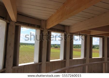 Russia, Nikola-Lenivets - 23 July 2017. White wooden rotunda with many doors in the Art Park Nikola Lenivets. Festival of landscape objects Archstoyanie. National park, Kaluga Region, Russia.  #1557260015